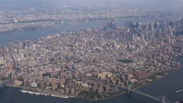 A daytime aerial establishing shot of the island of Manhattan.  Royalty-free stock video