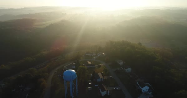 An early foggy autumn sunrise establishing shot over a typical New England residential neighborhood.   Royalty-free stock video