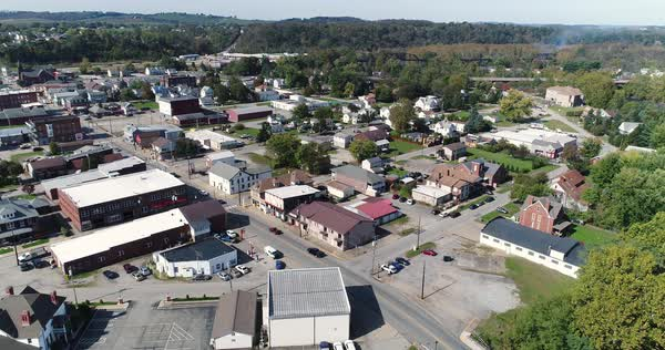 A slowly moving forward aerial shot of the business district of Connellsville, Pennsylvania, a small town in Southwestern Pennsylvania. Pittsburgh suburbs.   Royalty-free stock video