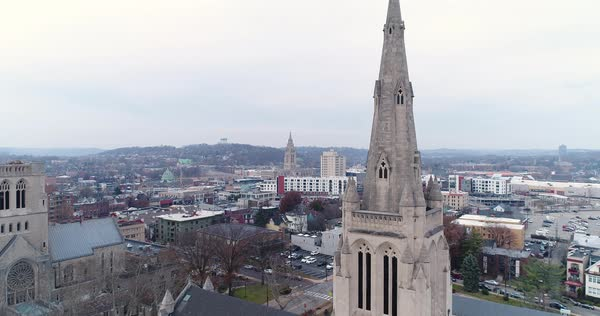 A daytime winter overcast forward aerial shot of the spire on Calvary Episcopal Church in Pittsburgh's Shadyside District.  Royalty-free stock video