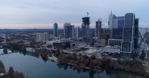 A slow forward aerial evening establishing shot of the Austin, Texas skyline.   Royalty-free stock video