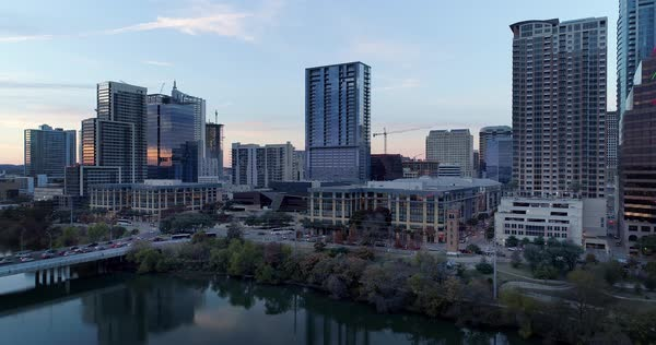 A slow reverse aerial establishing shot of the Austin, Texas skyline on an early Winter evening.   Royalty-free stock video