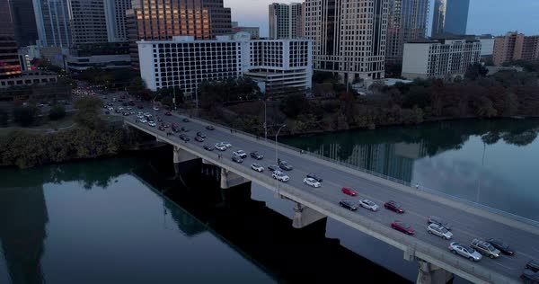 A high angle orbiting view of evening rush hour traffic on the S Congress Avenue Bridge in Austin, Texas.   Royalty-free stock video
