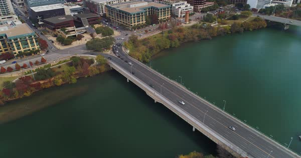 A high angle aerial tilt down of traffic on the South 1st Street Bridge over the Colorado River in downtown Austin, Texas.   Royalty-free stock video