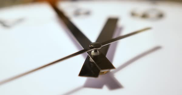 An extreme close up of the hands on a typical household wall clock. Shallow depth of field.   Royalty-free stock video