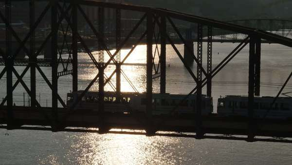 A subway car takes passengers over the Monongahela River in downtown Pittsburgh, PA at dusk. Royalty-free stock video