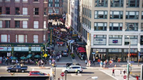 CLEVELAND, OH - Circa August, 2014 - An establishing shot of the busy and popular East 4th Street in downtown Cleveland, Ohio. Royalty-free stock video