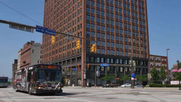 CLEVELAND, OH - Circa August, 2014 - An establishing shot of traffic and buildings on Superior Avenue in downtown Cleveland, OH. Royalty-free stock video