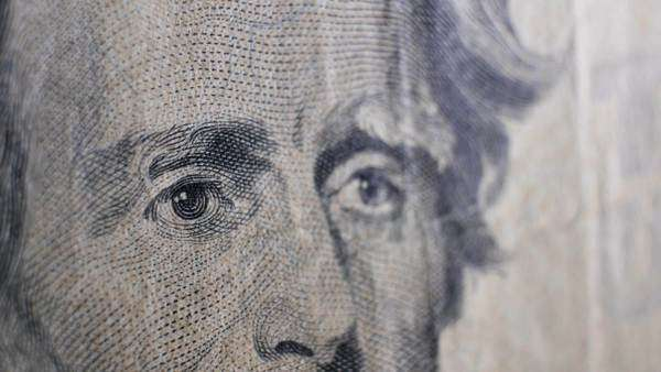 An extreme close-up macro shot of a $20 bill featuring Andrew Jackson's face. Royalty-free stock video