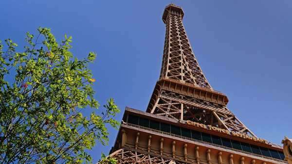 LAS VEGAS, Circa April, 2015 - An establishing shot of the Eiffel Tower outside of the Paris Hotel and Casino in Las Vegas. Royalty-free stock video