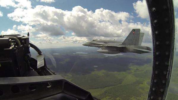 Passenger POV after take-off, with other F18 fighter plane flying in formation beside jet in full view in the summer, cloudy sky. Royalty-free stock video