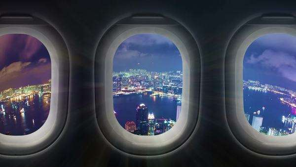 Timelapse video of city at night through airplane window Royalty-free stock video