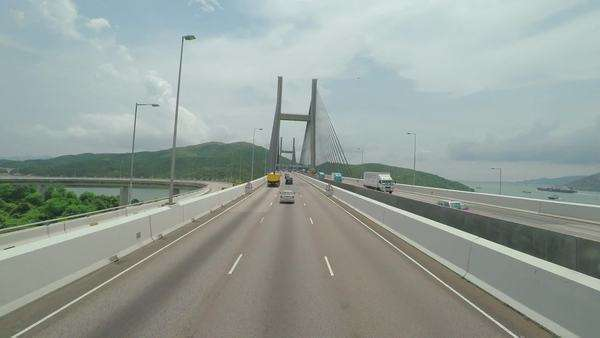 Hong Kong, China - June 12, 2015: Driving along the suspension bridges that are part of the highway connecting the Hong Kong International airport to the city center Royalty-free stock video