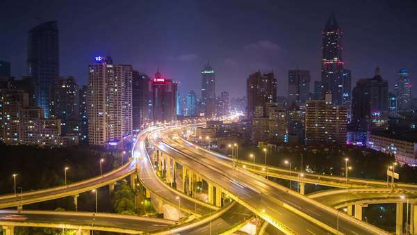 The Nine Dragons Pillar Interchange in Shanghai. Static wide night shot. Rights-managed stock video