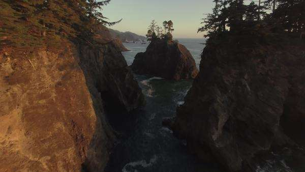 Aerial shot of Samuel H Boardman State Park along the Oregon Coast, flying close over sea stacks. Rights-managed stock video