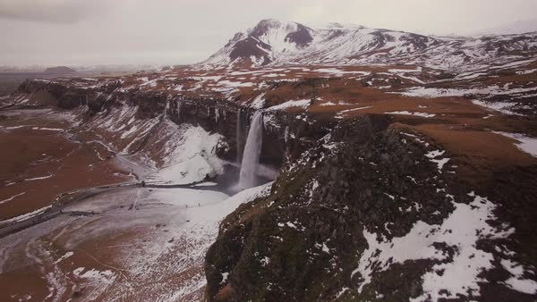 Aerial fly over Seljalandsfoss waterfall in Iceland.  Rights-managed stock video