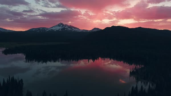 Oregon Broken Top Mountain Lake sunrise aerial Rights-managed stock video