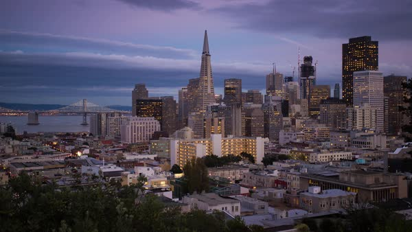 San Francisco Skyline, Day-To-Night Sunset timelapse. Rights-managed stock video