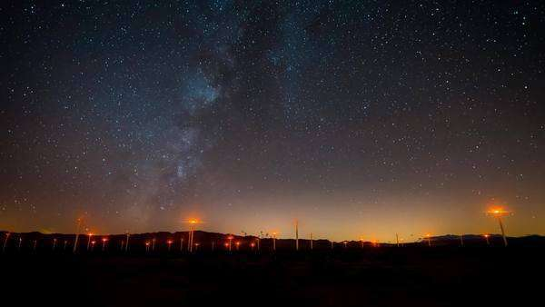 Timelapse static shot of Wind Turbines with Milky Way in the Anza Borrego Desert. Rights-managed stock video