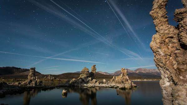 Timelapse dolly shot of Mono Lake moonrise with the milky way. Rights-managed stock video