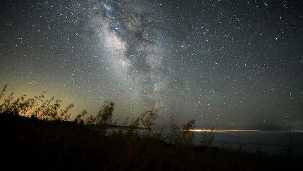 Timelapse, Dolly, Santa Barbara Milky Way mountain view above fog in field.  Rights-managed stock video