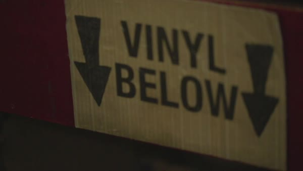 Hand-held shot of vinyl records for sale in a record store in London Royalty-free stock video
