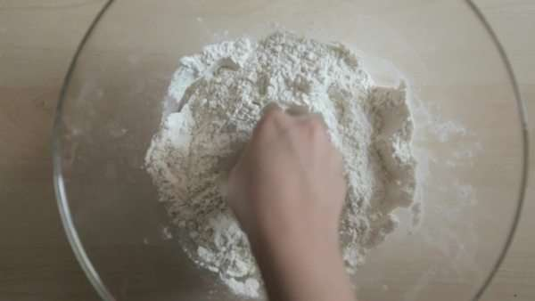 From above shot of hands creating a hole in a bowl of flour Royalty-free stock video