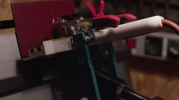 Hand-held shot of a woman stamping a piece of leather with a machine Royalty-free stock video
