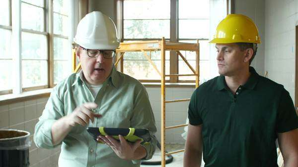 Architect and contractor touring building Royalty-free stock video
