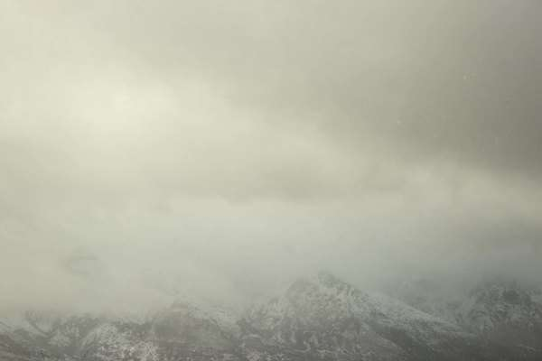 Wide shot of clouds above a snow-covered mountain Royalty-free stock video