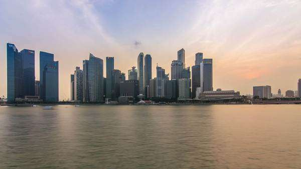 Singapore, Singapore 30/08/2015: Singapore skyline cityscape day to night timelapse, sun going down over financial district bay view city lighting up Royalty-free stock video