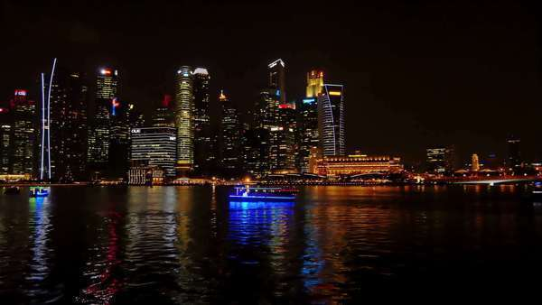 Singapore,indonesia,15/08/2015:singapore seafront marina bay illuminated at night modern city skyscrapers background pan panoramic view Royalty-free stock video