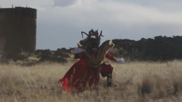 Wide shot of a Peruvian dancer on a meadow in Puno Royalty-free stock video