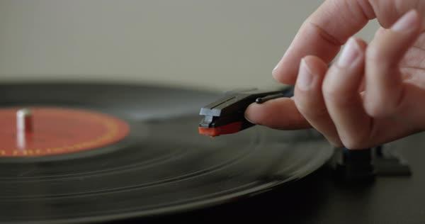 Hand Places Retro Record Player Needle Onto Vinyl Royalty Free Stock Video