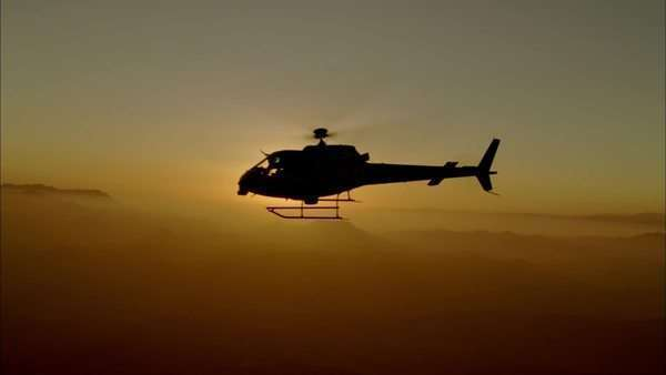 Aerial shot of a helicopter flying in the sky Royalty-free stock video