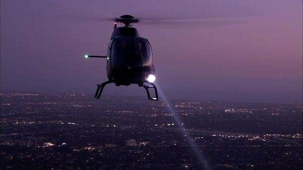Handheld shot of a flying helicopter at night Royalty-free stock video
