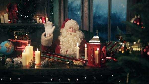 santa claus saying merry christmas and waving while camera slides royalty free