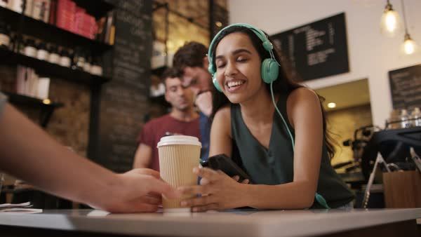 Smiling women in cafe with headphones. Royalty-free stock video