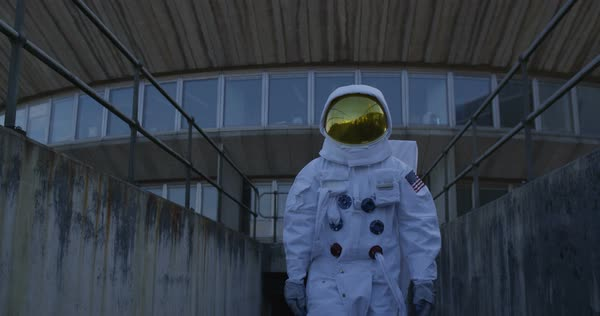 Astronaut on an exploration trip, walking away from mission control building. Royalty-free stock video