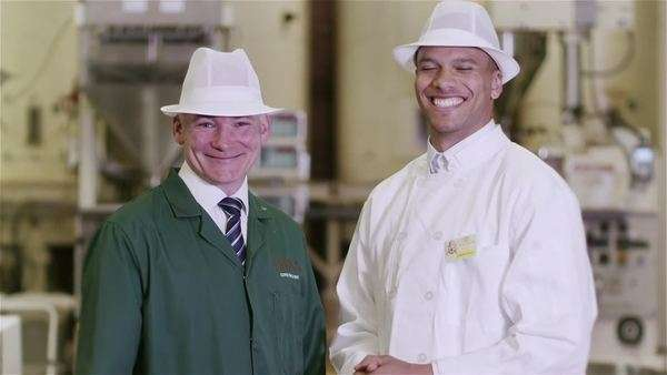 Portrait of friendly smiling factory workers in the food and drink industry. Royalty-free stock video