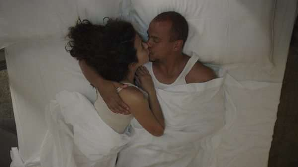 Attractive passionate couple in bed together, talking and making love Royalty-free stock video