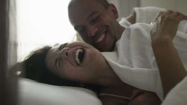 Sexy happy couple, laughing together in the bedroom. Royalty-free stock video