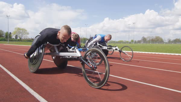 Athletics team in wheelchairs competing in a race at race track Royalty-free stock video