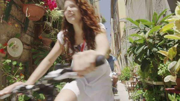 Attractive couple cycling in small Italian town and having fun Royalty-free stock video