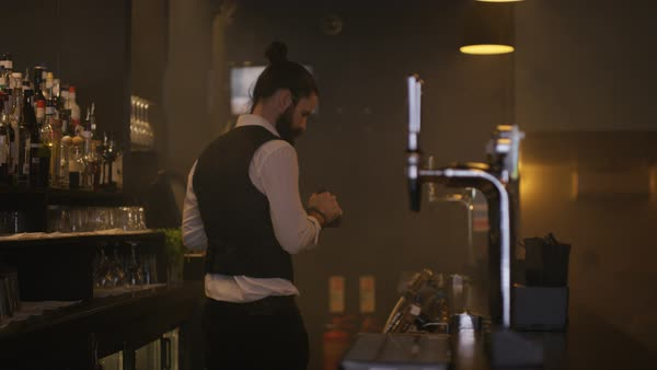 Bartender in city bar pouring and serving drinks Royalty-free stock video