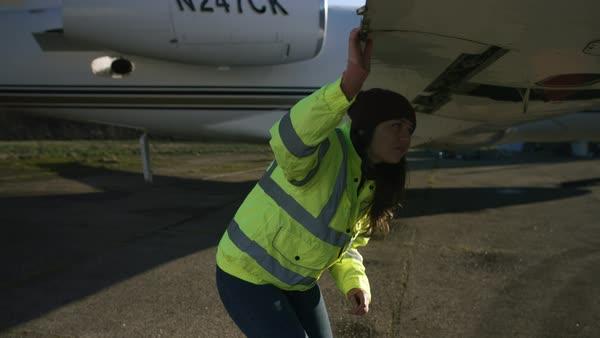 Directing plane on landing strip