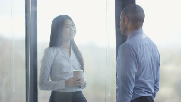 Happy business man and woman chatting in the office. Royalty-free stock video