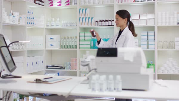 Portrait of friendly smiling worker in a chemist shop. Royalty-free stock video