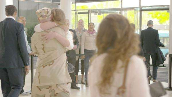 Romantic reunion at the airport, a soldier returns home to the embrace of his loved one Royalty-free stock video