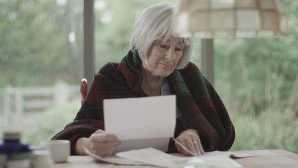 Portrait of senior woman worrying about paying the bills Royalty-free stock video